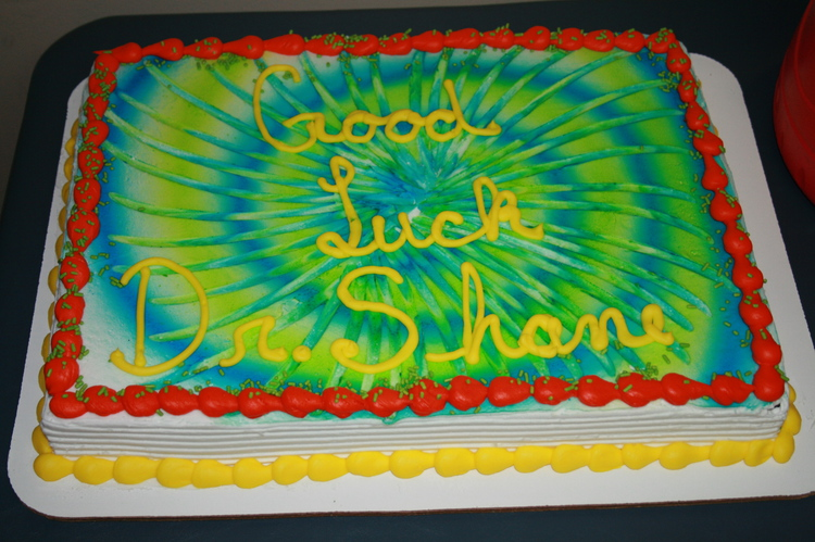 Image of a cake that reads good luck Dr. Shane