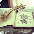 Image of a spine model on a book with images of a spine model